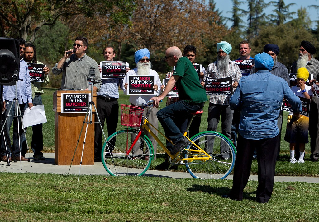 Members of OMFI (organization for minorities of India) protest the upcoming visit of Indian prime minister Narendra Modi to Google at Charleston Park near the GooglePlex in Mountain View, Calif., on Friday, Sept. 18, 2015. OMFI members oppose Modi's record of genocide and criminalization of religious freedom. (LiPo Ching/Bay Area News Group)