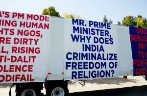 An OMFI (organization for minorities of India) sponsored truck displays signs critical of Indian prime minister Narendra Modi during a protest of the upcoming visit of the prime minister to Google at Charleston Park near the GooglePlex in Mountain View, Calif., on Friday, Sept. 18, 2015. OMFI members oppose Modi's record of genocide and criminalization of religious freedom. (LiPo Ching/Bay Area News Group)